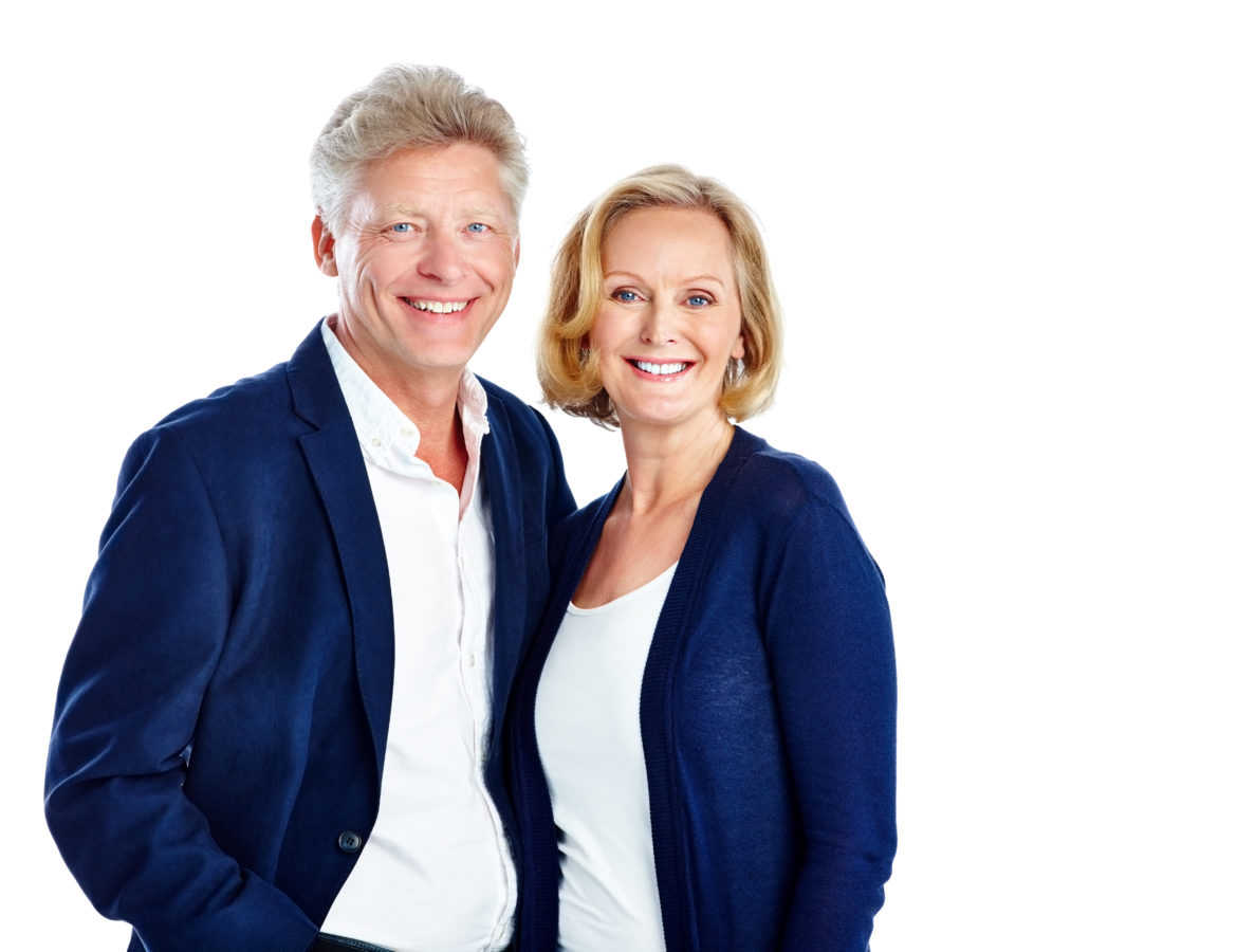 Studio shot of happy mature couple standing together on white background with copyspace